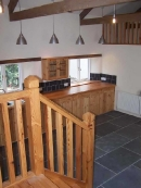 pine-stairs-slate-floor
